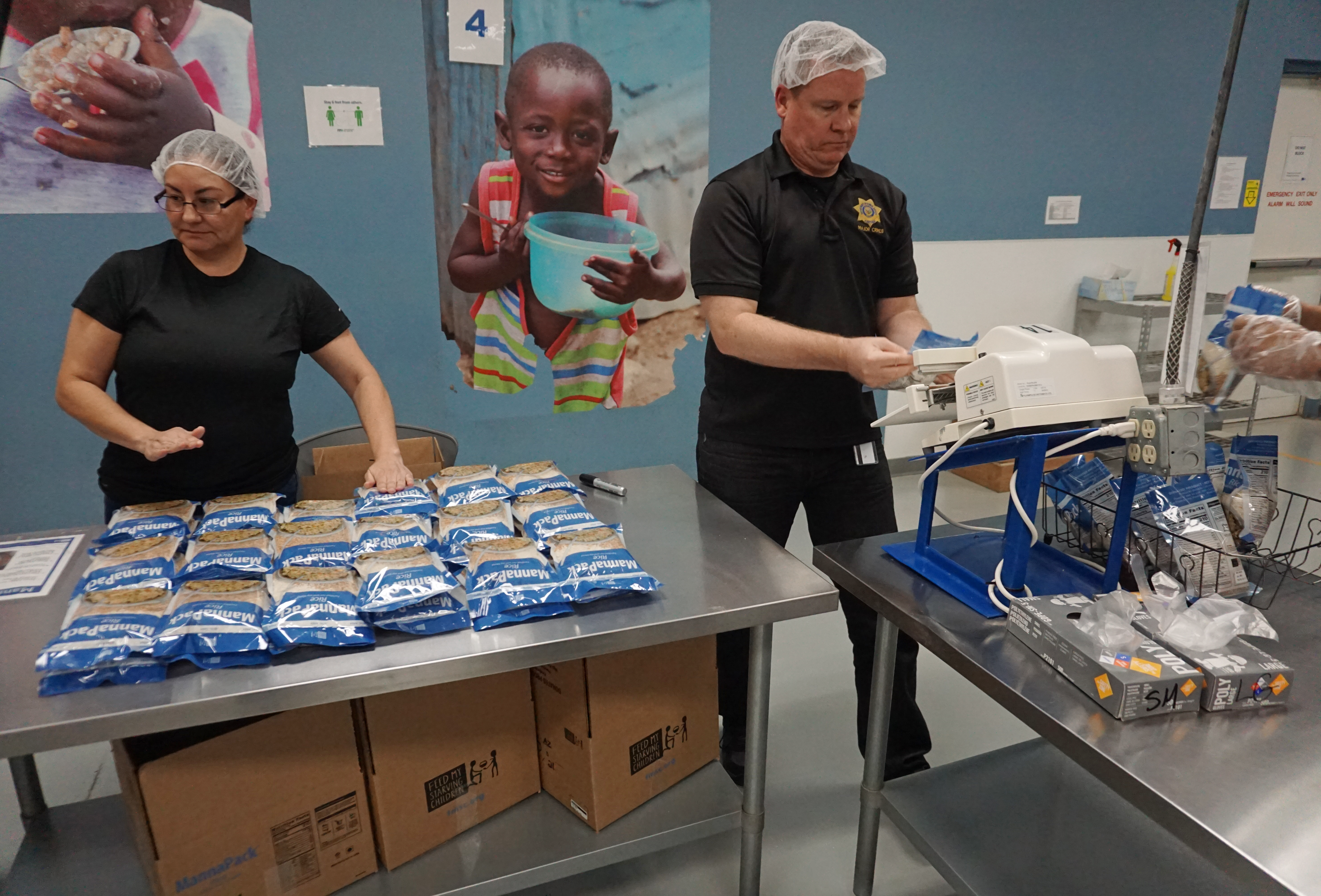 People packing food items for charity