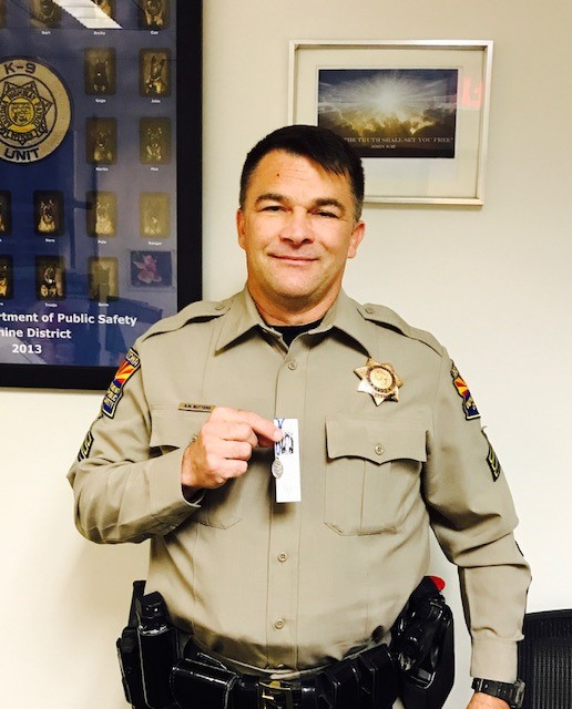 Sgt. Butters holding St. Michael medal