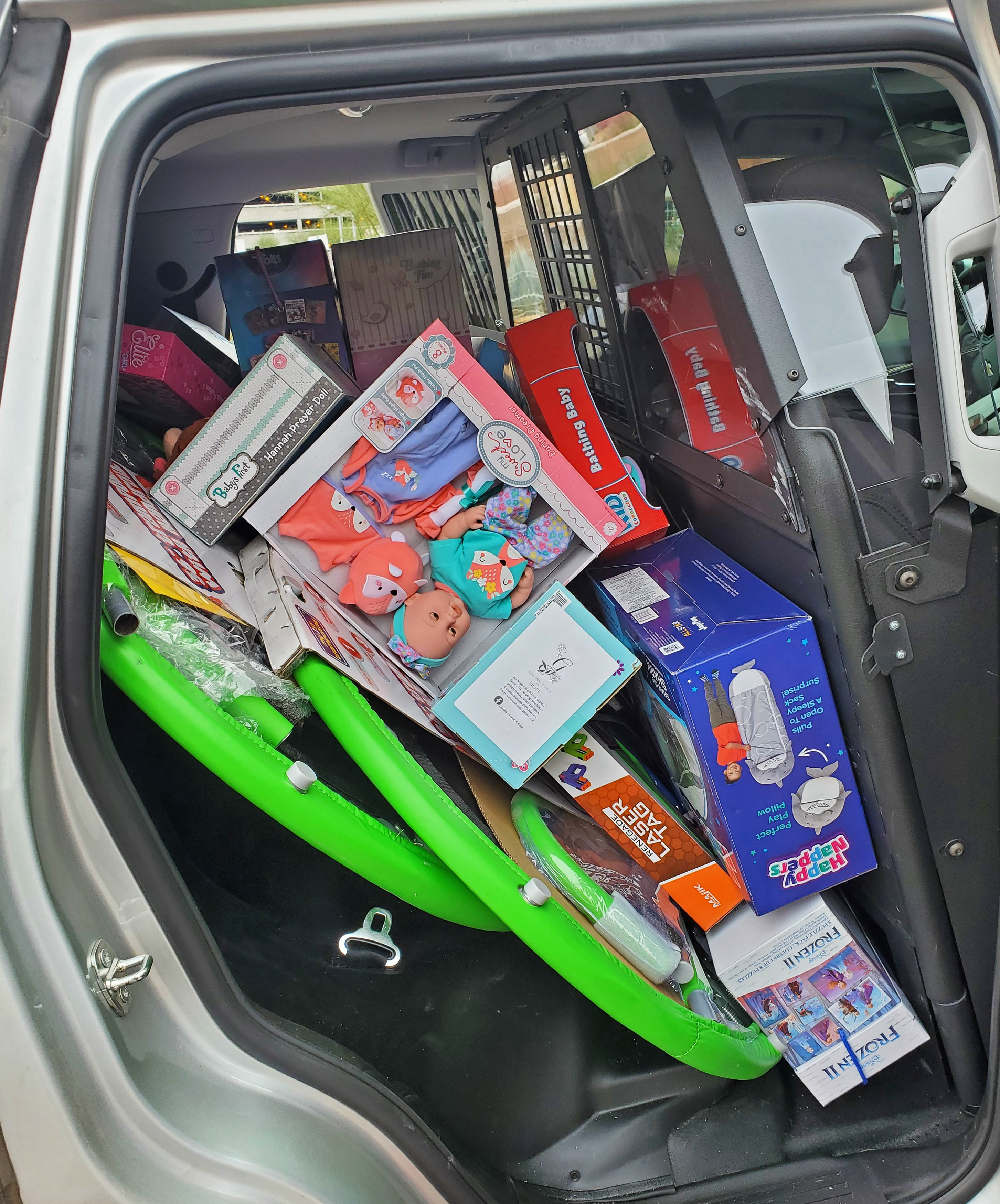 Holiday Toy Drive Toys in AZDPS Vehicle