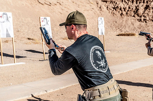 A DPS Trooper can be seen here training with a new handgun.